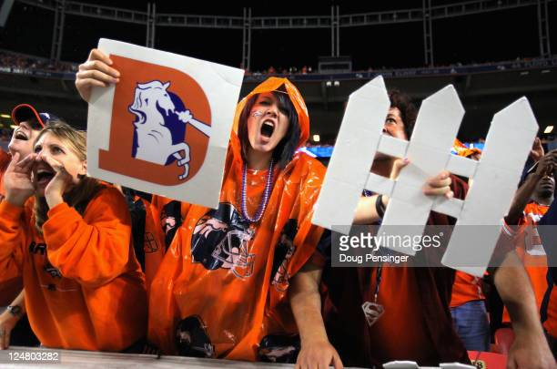 Fans support the Denver Broncos defense as they face the Oakland Raiders at Sports Authority Field at Mile High on September 12 2011 in Denver...