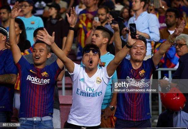 Fans support their team during a warm up prior to the Supercopa de Espana Supercopa Final 1st Leg match between FC Barcelona and Real Madrid at Camp...