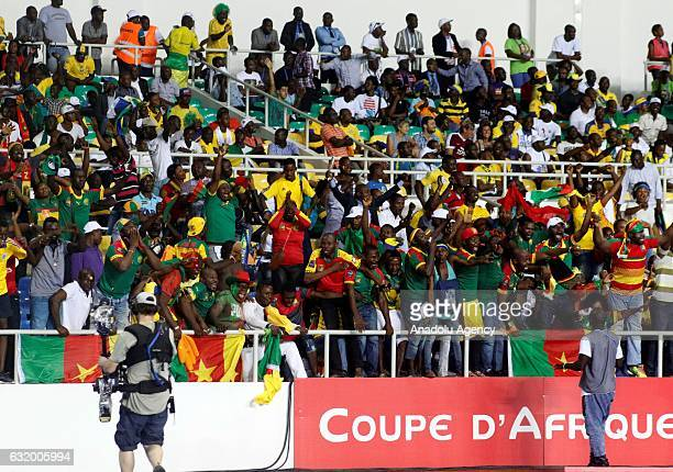 Fans support their team during the 2017 Africa Cup of Nations group A football match between Cameroon and Guinea Bissau at the l'Amitié stadium in...