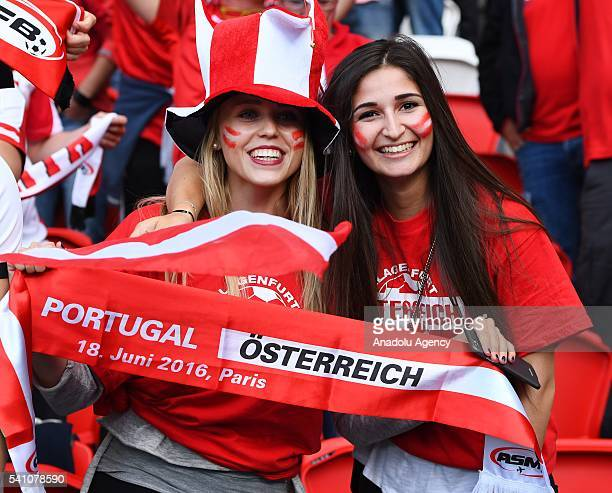 Fans support their team during the EURO 2016 Group F football match between Portugal and Austria at the Parc des Princes in Paris, France on June 18,...