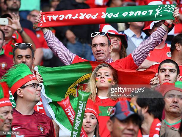 Fans support their team during the EURO 2016 Group F football match between Portugal and Austria at the Parc des Princes in Paris France on June 18...