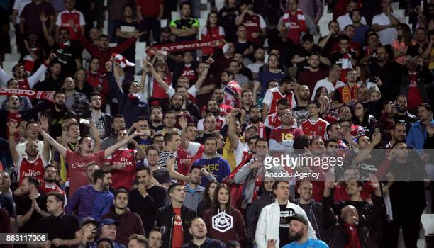 Fans support their team during the UEFA Europa League Group H soccer match between Crvena Zvezda and Arsenal at Rajko Mitic Stadium in Belgrade...