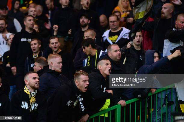 Fans support their team during the UEFA Europa League Play Off First Leg match between Celtic and AIK at Celtic Park on August 22, 2019 in Glasgow,...