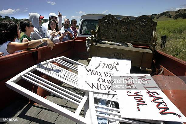 Fans surround a car that was removing signs in support of Pop icon Michael Jackson on the road to his Neverland Ranch in Los Olivos, CA 09 June 2005....