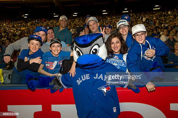 Fans surround Ace the Toronto Blue Jays mascot prior to the game between the Cincinnati Reds and the Toronto Blue Jays at Olympic Stadium on Friday...