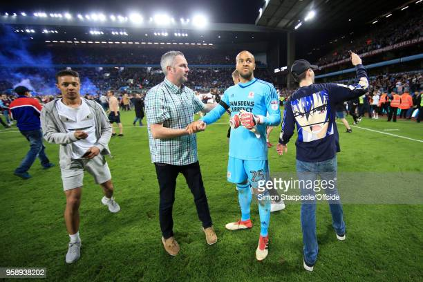 Fans surround dejected Boro goalkeeper Darren Randolph at the end of the Sky Bet Championship Play Off Semi Final Second Leg match between Aston...