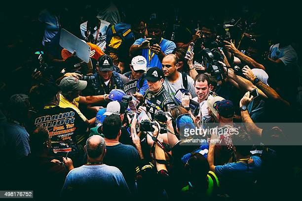 Fans surround Jeff Gordon driver of the AXALTA Chevrolet during practice for the NASCAR Sprint Cup Series Ford EcoBoost 400 at HomesteadMiami...