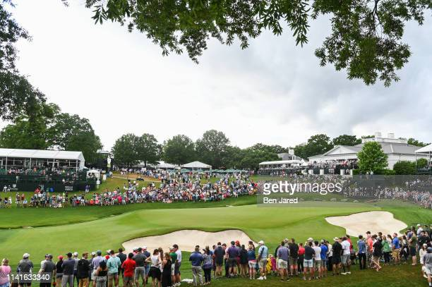 Fans surround the eighteenth hole during the final round of the Wells Fargo Championship at Quail Hollow Club on May 5, 2019 in Charlotte, North...