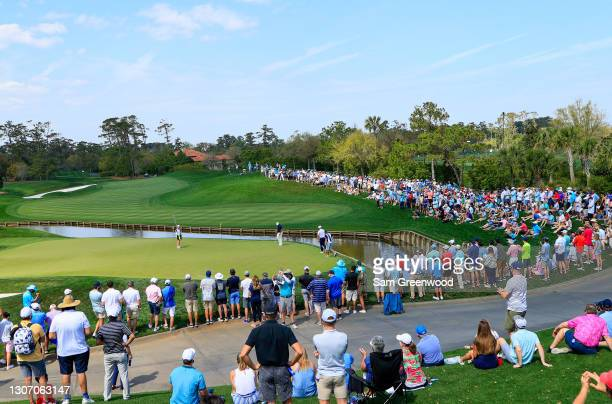 Fans surround the fourth green during the final round of THE PLAYERS Championship on THE PLAYERS Stadium Course at TPC Sawgrass on March 14, 2021 in...