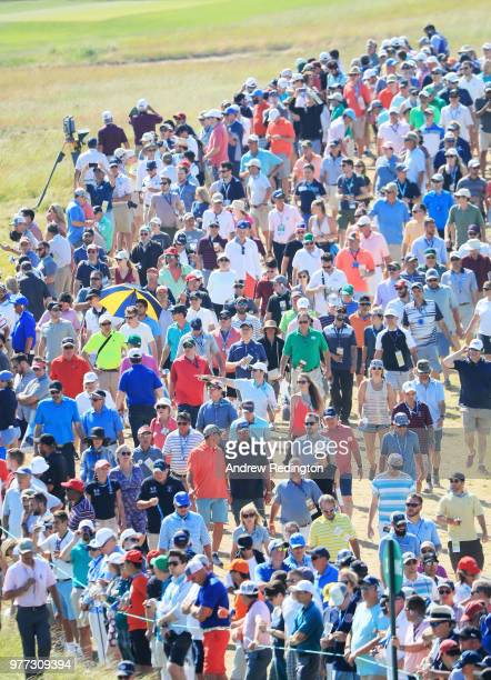 Fans surround the ninth green during the final round of the 2018 US Open at Shinnecock Hills Golf Club on June 17 2018 in Southampton New York