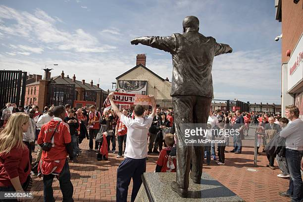 Fans surrounding the statue of former Liverpool manager Bill Shankly outside Anfield home of Liverpool football club pictured before the club took on...