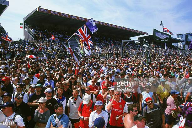 Fans swarm on the track at the end of the Le Mans 24 hour Endurance Race at the Circuit de la Sarthe in Le Mans France on June 15 2002