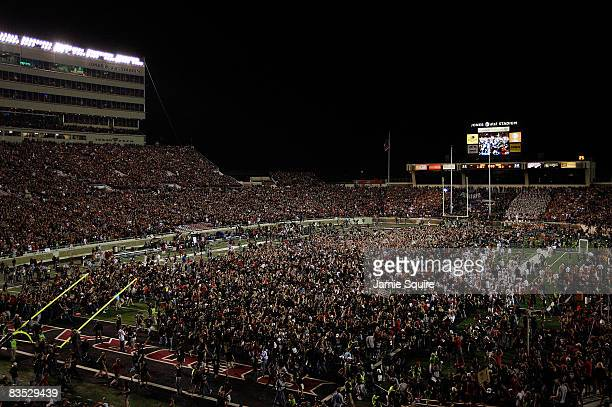 Fans swarm the field after the Texas Tech Red Raiders defeated the Texas Longhorns with a final score of 3433 on November 1 2008 at Jones Stadium in...