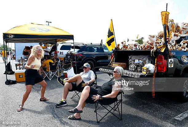 Fans tailgate ahead of the game between the Delaware State Hornets and the Missouri Tigers at Faurot Field/Memorial Stadium on September 24, 2016 in...