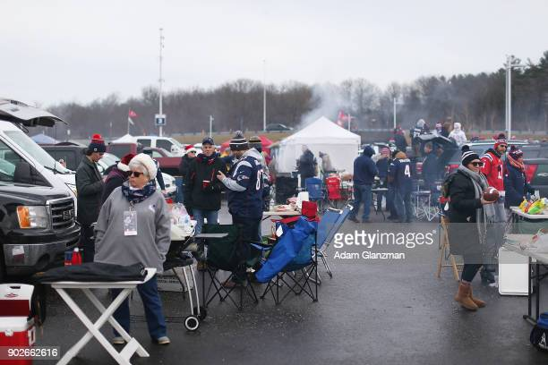 Fans tailgate before a game between the New England Patriots and the Buffalo Bills at Gillette Stadium on December 24 2017 in Foxboro Massachusetts