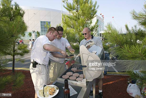 Fans tailgate before game four of the NHL Stanley Cup Finals between the Detroit Red Wings and the Carolina Hurricanes on June 10 2002 at the...