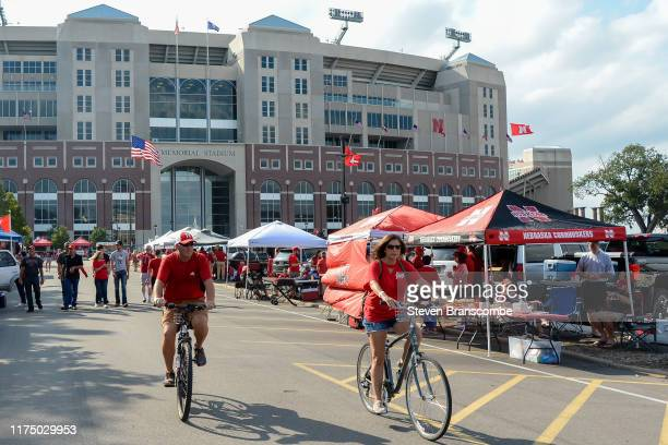 Fans tailgate before the game between the Nebraska Cornhuskers and the Northern Illinois Huskies at Memorial Stadium on September 14 2019 in Lincoln...