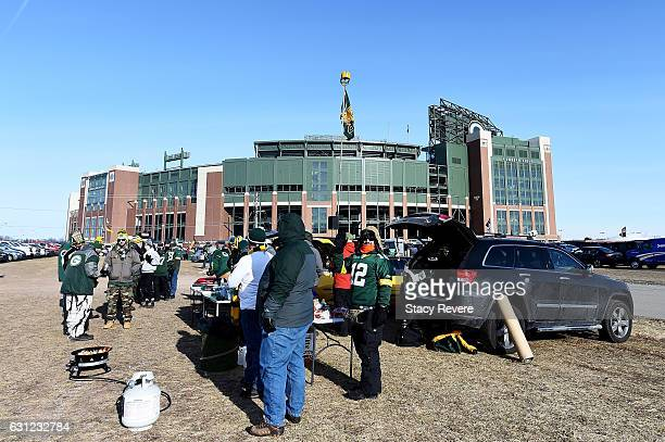 Fans tailgate before the NFC Wild Card game between the Green Bay Packers and the New York Giants at Lambeau Field on January 8, 2017 in Green Bay,...