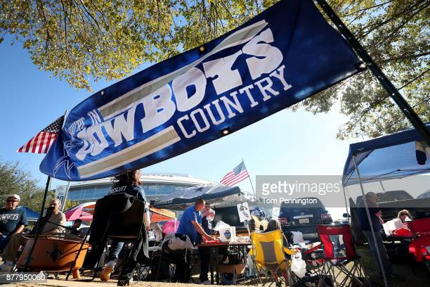 Fans tailgate beofre the Dallas Cowboys take on the Los Angeles Chargers during a Thanksgiving Day game at ATT Stadium on November 23 2017 in...