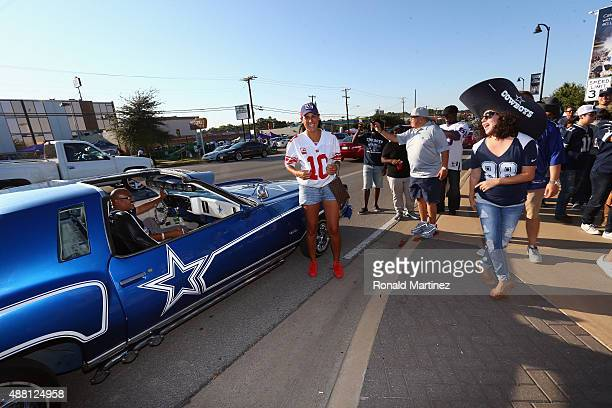 Fans tailgate next to a Monte Carlo with Dallas Cowboys logos before a game against the New York Giants at ATT Stadium on September 13 2015 in...