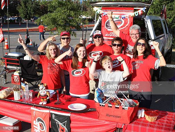 Fans tailgate prior to a NHL game between the Carolina Hurricanes and the Tampa Bay Lightning on October 7 2011 at RBC Center in Raleigh North...