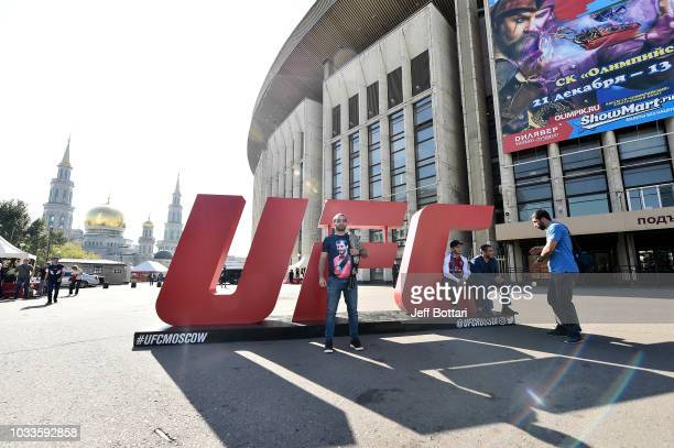 Fans take a photo in front of the UFC letters during the UFC Fan Experience at the UFC Fight Night event at Olimpiysky Arena on September 15 2018 in...