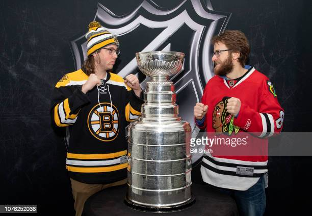 Fans take a photo with the Stanley Cup at the Bridgestone NHL Winter Classic Park fan festival at Millenium Park on December 31 2018 in Chicago...
