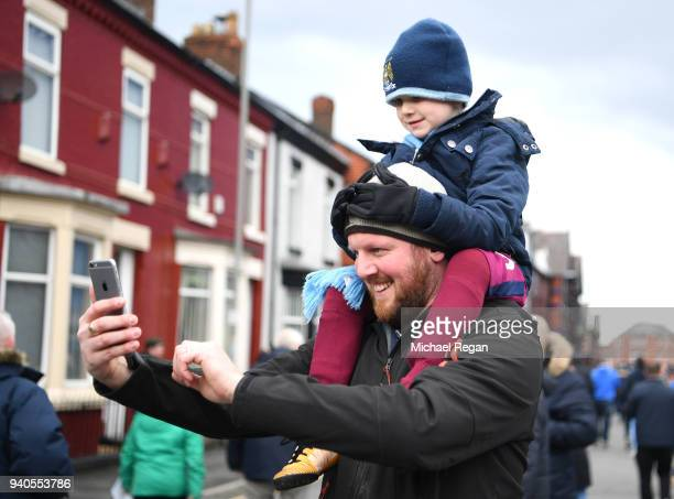 Fans take a photograph prior to the Premier League match between Everton and Manchester City at Goodison Park on March 31 2018 in Liverpool England