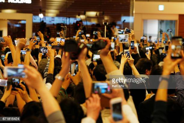 Fans take a picture of Paul McCartney as he arrives at Haneda Airport on April 23 2017 in Tokyo Japan