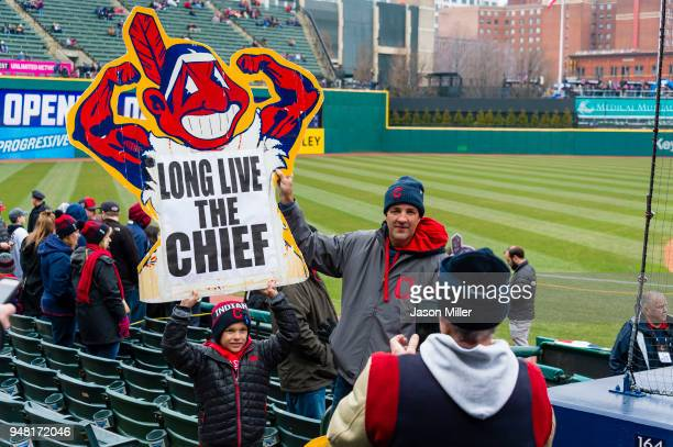Fans take a picture with a Chief Wahoo logo prior to the game against the Kansas City Royals at Progressive Field on April 6 2018 in Cleveland Ohio...