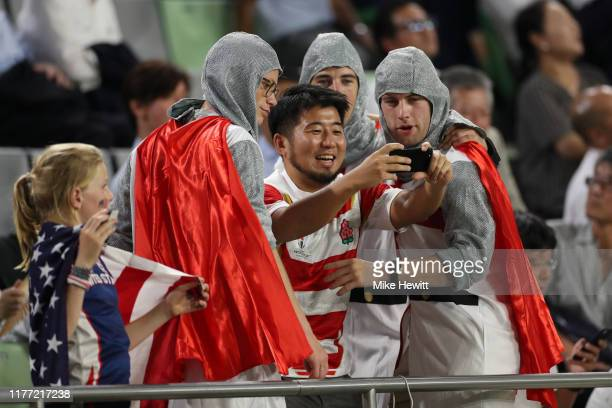 Fans take a selfie during the Rugby World Cup 2019 Group C game between England and USA at Kobe Misaki Stadium on September 26 2019 in Kobe Hyogo...