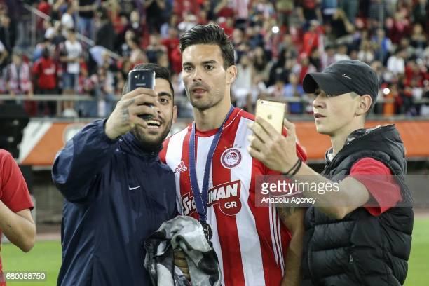 Fans take a selfie with Alberto Botia of Olympiacos during their championship celebration of Superleague Greece at Georgios Karaiskakis Stadium in...