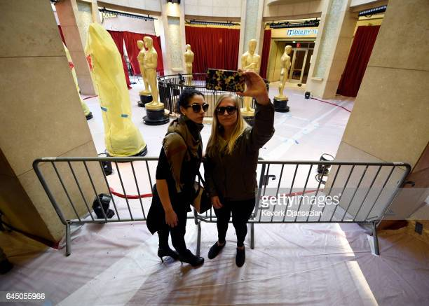 Fans take a selfle with the Oscar statue placed in the rotunda of the Dolby Theater as preparation for the 89th Academy Awards continue at Hollywood...