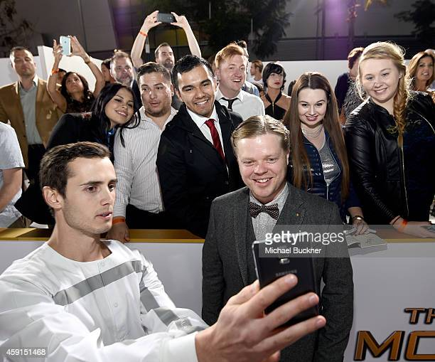 Fans take a Wide Angle Selfie with actor Elden Henson using the new Samsung Galaxy Note 4 at the release of The Hunger Games: Mockingjay - Part 1 on...