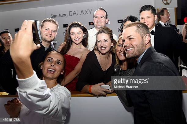 Fans take a Wide Angle Selfie with actor Wes Chatham using the new Samsung Galaxy Note 4 at the release of The Hunger Games Mockingjay Part 1 on...