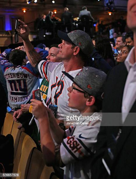 Fans take cell hpone pictures during the 2016 NFL Draft at the Auditorium Theater on April 28 2016 in Chicago Illinois
