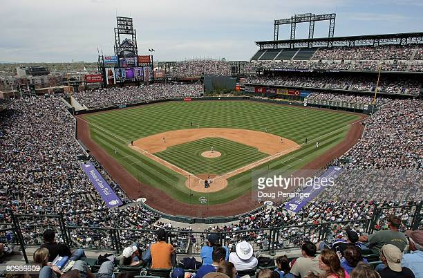 Fans take in the fair weather and the game between the Colorado Rockies and the Los Angeles Dodgers at Coors Field on May 4, 2008 in Denver,...