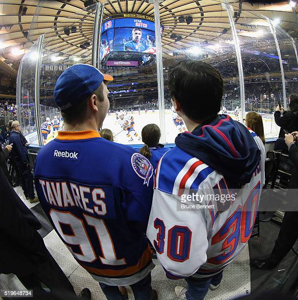 Fans take in warmups prior to the game between the New York Rangers and the New York Islanders at Madison Square Garden on April 7 2016 in New York...