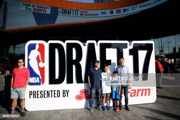 Fans take memorial photos before attending NBA Draft 2017 in Brooklyn borough of New York United States on June 22 2017