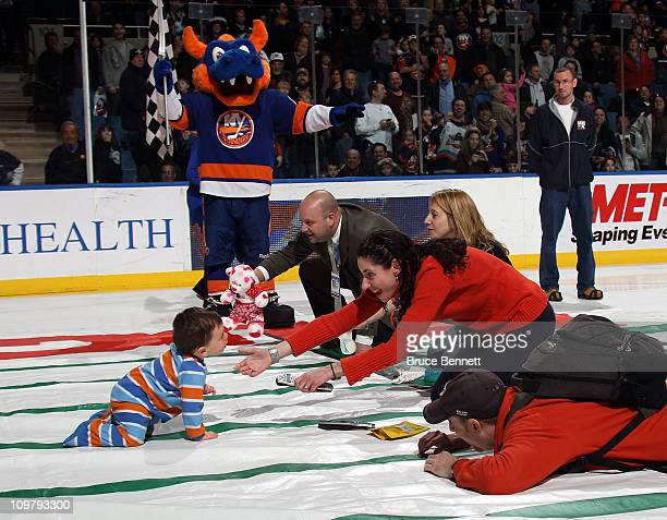Fans take part in a baby race between periods of the game between the New York Islanders and the St Louis Blues at the Nassau Coliseum on March 5...