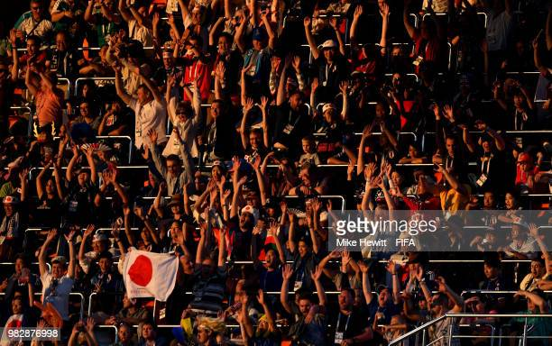 Fans take part in a Mexican wave during the 2018 FIFA World Cup Russia group H match between Japan and Senegal at Ekaterinburg Arena on June 24 2018...