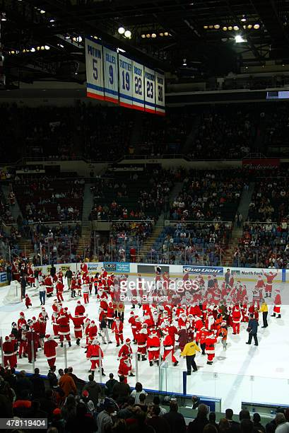 Fans take part in a Santa Claus promotion during a New York Islander game on December 23 2003 at the Nassau Coliseum in Uniondale New York