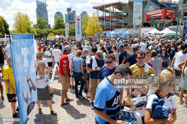 Fans take part in the Tottenham Hotspur Tailgate Zone prior to the match against Manchester City in the International Champions Cup 2017 at Nissan...