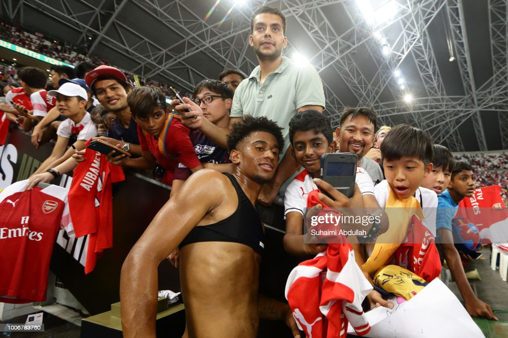 Fans take photo with Reiss Nelson of Arsenal after the International Champions Cup match between Arsenal and Paris Saint Germain at the National Stadium on July 28, 2018 in Singapore.
