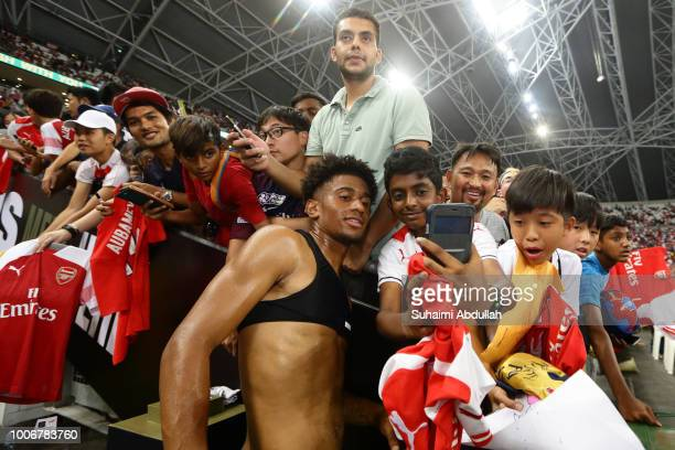 Fans take photo with Reiss Nelson of Arsenal after the International Champions Cup match between Arsenal and Paris Saint Germain at the National...