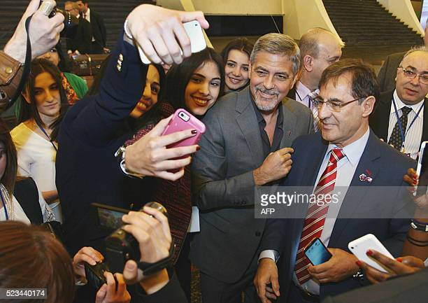 Fans take photo with US actor George Clooney in Yerevan where he is participating in the Second International Forum Against Crime and Genocide on...