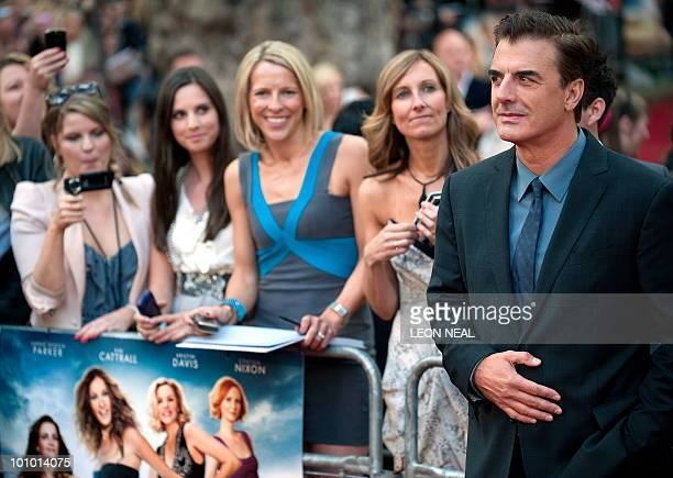 Fans take photographs of US actor Chris Noth as he arrives at the UK premiere of 'Sex and the City 2' in Leicester Square central London on May 27...