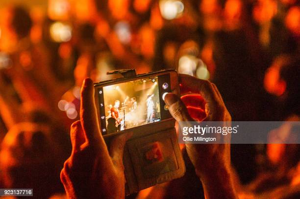Fans take photographs with mobile phones as the The Vamps performs onstage for War Child during BRITs Week 2018 at Dingwalls on February 22, 2018 in...