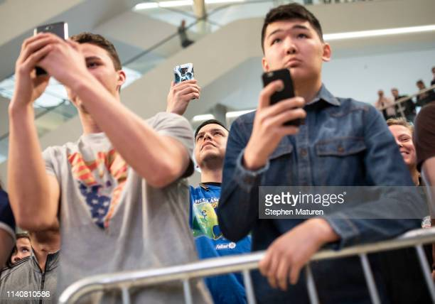 Fans take photos as Robbie Lawler performs during the UFC Fight Night Open Workouts event at the Mall of America on May 2 2019 in Minneapolis...