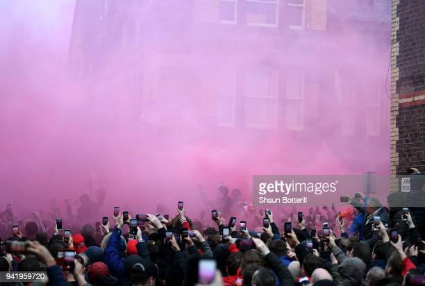 Fans take photos as the Manchester City team bus arrives prior to the UEFA Champions League Quarter Final Leg One match between Liverpool and...